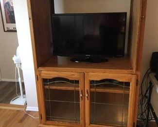 Entertainment center with claw feet.