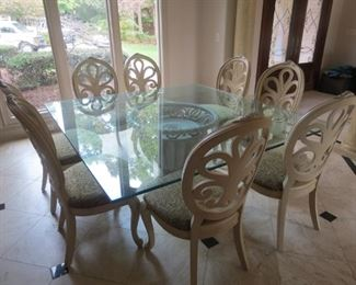 AVAILABLE FOR EARLY SALE.  $3000.00.  MASSIVE HENREDON GLASS TOP TABLE AND 8 CHAIRS.  TABLE IS 6 FT. X 6 FT.  GLASS IS 1 INCH THICK.
