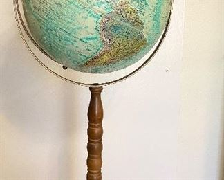 "Vintage ""Replogle"" World Ocean Series globe on stand. 12"" diameter raised relief globe. Metal base and walnut wooden spindle stand. Measures 32"" tall. See additional photos for close up. One spot shows wear area. $80"