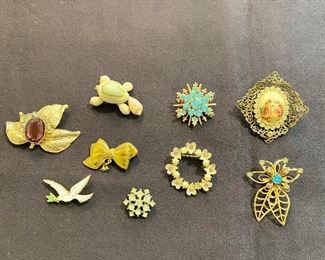 Vintage brooches. All are good with no missing stones and clasp's are good. None are marked. Lot of (9) - $30