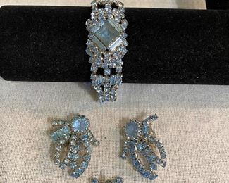 Matching costume jewelry set. Bracelet, clip earrings and brooch. Aqua marine stones and silver colored settings. All in mint condition with no missing stones and good clasp. Unmarked. $35