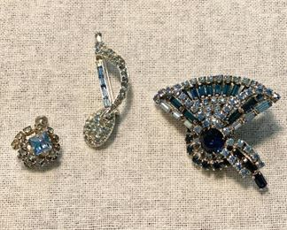 Vintage pin brooch aqua marine/blue stones set in silver tone, music note pin missing some stones, one screw on earring with stones. Lot of (3) $15