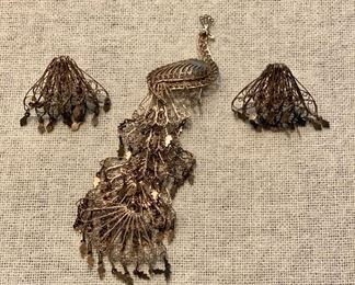 Vintage set of screw on earrings and peacock brooch pin. Unmarked gold tone filigree. $12