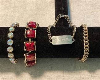 "Lot of 4 bracelets - Vintage unmarked rhinestones, ""Coro"" Pegasus "" (1945-1955) red fleck lucite linked stones, engraved sweetheart bracelet, unmarked chain bracelet. $25"