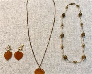 Vintage Colorado Real Aspen  made necklace and screw on earrings. Second necklace is gold tone chain with gold beads and embossed gold beads. Excellent condition. Lot of (2) $10