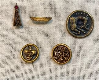 "Vintage lot of pins, top row left to right = ""TV50"" red ruby pin, very old ""Unity"" pin, old double sided coin. Bottom row old gold tone pin with crown and old gold tone pin with unknown marking. All good pin backs. (Lot of 5) $7"