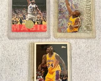 "Shaquille O'Neal Cards - Fleer Metal  #183 ,""1996-97"", Upper Deck #173,  ""1995"" NBA second all star team, Topps ""1996"" NBA's top ten in scoring. Cards are in excellent condition & have been in cases. (Lot 3) $50"