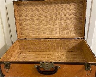 Additional photo of interior of unmarked suitcase.