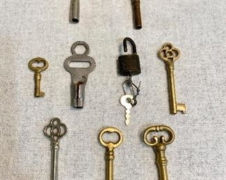 "Lot of old keys - Top = Clock keys, middle row is a old skate key, a mini padlock marked ""SLC"" made in USA. Others are skelton keys. (Lot of 9) $10"