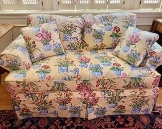 $395 - Floral one cushion love seat with two large back pillows and two throw pillows; 30 in. (H) x 60 in. (W) x 38 in. (Depth)