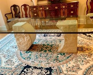 """Sculptured stone base with 7'4"""" by 4' glass top table"""