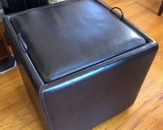 Storage ottoman that has reversible top that becomes a tray......