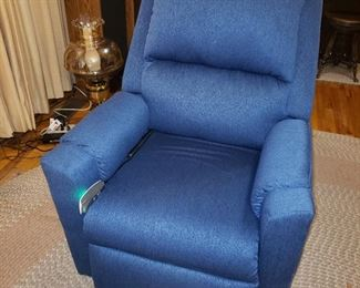'Lift' Recliner..Excellent condition .  This is a very expensive piece of furniture that was hardly used.