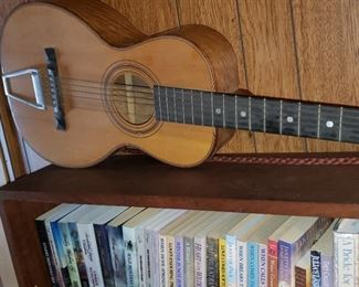 This is a collectible Guitar - Howard Eugene Wurlitzer. 1910 s Eugene Howard Slothead Parlor Guitar. Rosewood Head.
