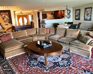 Large velvet sectional sofa, coffee table & huge rug