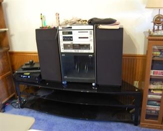 Stereo on top of a Glass top TV stand
