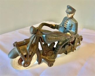 """$295; - Vintage cast iron miniature motorcycle with police officer with paint in very good condition; """"Champion"""" motorcycle; 4 1/2 in. (H) x 7 in. (L)"""