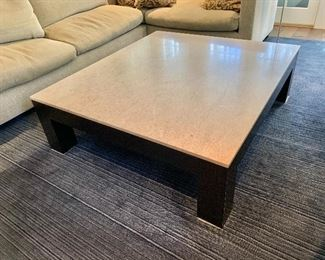 "$895; Large custom made coffee table with limestone top and wood base; 16"" H x 54"" W x 48"" D"