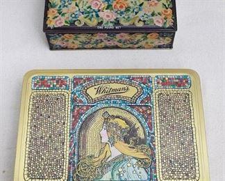 "$15 Upper: Vintage rectangular candy tin, floral design, hinged lid, Schrafft's chocolates.  L: 8""   W: 5""   H: 2.5""  $30 Lower SOLD! : Rectangular candy tin, art nouveau design, Whitman's Salmagundi.  L: 10""   W: 8.5""   H: 1.5"" [Props]"