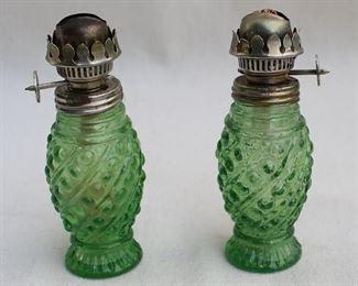 "$40 Set of 2 green pressed glass kerosene lamps, metal mounts, glass shades missing.  H: 5""    diameter: 2"" [Bin 38]"