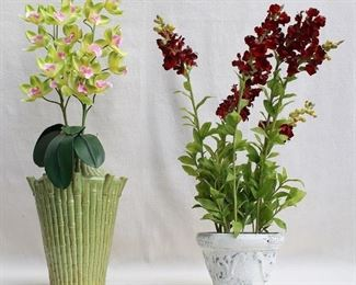 """$25 Left: Green ceramic vase, bamboo motif, contains green/purple plastic orchids.  W: 9""""   H: 12.5""""      height w/ flowers: 29"""" $20 Right: Painted resin flower pot, contains red plastic snapdragons.  W: 8""""   H: 5.5""""      height w/ flowers: 25"""" [Props]"""