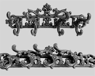 """$40 each Wall-mounted dark cast metal coat rack, reproduction Victorian, 4 collapsible double hooks, 2 holes for hanging.  W: 15""""   H: 5.5""""   D: 4.5"""" - 2 available.  [Bin 37]"""