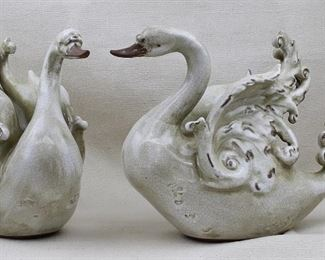 """$40 Set of 2 ceramic swans, antiqued crackled cream finish, breasts embossed w/ symbols.  L: 14""""   W: 5""""   H: 10.5"""" AS IS: one tail mended [Props]"""
