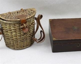 """$30 Left: Fishing creel, wicker, leather/wood clasp, leather strap.  W: 8""""   H: 7.5""""   D: 4.5"""" $30  Right: Vintage mahogany box, faded gilded decoration on outside, painted flowers on inside of hinged lid, contains bandages.  L: 10""""   W: 7""""   H:  3.5"""" [Bin 36]"""