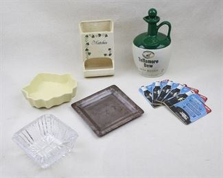 """$30 Lot:  Glazed ceramic wall match holder labeled """"Matches"""", cream color w/ ivy decoration, hole for hanging (W: 4""""   H: 6.5""""   D: 4"""");  glazed ceramic maple leaf ash tray/candy dish, cream color ( W: 6""""   H: 6""""   D: 1.5"""");  square pressed glass ash tray, cigarette rests on corners (W: 5""""   H: 5""""   D: 2"""");  square hammered metal ash tray (W: 6""""   H: 6""""   D: 0.5"""");  ceramic whisky jug, green/white glaze, matching stopper, Tullamore Dew Irish Whiskey  (H: 8.5""""   diameter: 5"""" );  5 cardboard beer coasters, Guiness (new) (L: 4""""   W: 4"""") [Bin 36]"""