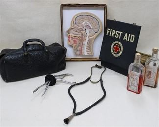 """$50  LOT Clockwise from left: Vintage Gladstone bag, leather or embossed leatherette.  L: 16""""   W: 7""""   H: 9"""" - Cutaway model of human head, in box.  Made in India.  W: 10""""   H: 13""""   D: 2"""" - Vintage Red Cross first aid kit, metal box containing original boxed bandages.   W: 9""""   H: 9.5""""   D: 3"""" - Vintage corked medicine bottles.  W: 3""""   H: 9""""   D: 2""""   1 pt.?  - Vintage stethoscope, metal & rubber.  L: 20""""   - Vintage forceps (obstetric?), metal & rubber.  L: 10""""   W: 5"""" [Bin 33]"""