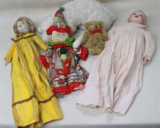 """LOT $45 - Girl doll, bisque head & hands, blond hair, painted eyes, long dress w/ mustard/brown stripes, bertha collar.  L: 17""""  - Clown doll, fabric, embroidered face.  L: 17""""   - White plush lamb w/ large black plastic eyes, long legs, leather cloven hooves.  L: 15.5""""   - Brown plush teddy bear, red bow around neck.  L: 6"""" - Baby doll, bisque head & hands, painted hair, glass eyes, pink patterned long cotton dress.  L: 15"""" [Bin 32]"""