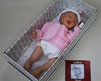 "$30 ""Sarah"" by Ashton-Drake Galleries - Lifelike newborn doll w/ pink onesie, jacket & hat, in box, w/ brochure.  L: 17"" [Bin 32a]"