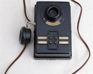 """$25 Vintage inter-office wall-mounted telephone, black celluloid, earpiece on 41"""" cord, 4 buttons.  W: 6.5""""   H: 7.5""""   D: 4"""" [Bin 31]"""
