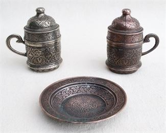 """$40 Turkish coffee set of 2 cast metal cups w/ white ceramic inserts and matching lids (one silvertone, one coppertone), plus matching coppertone plate.  W: 3.5""""   H: 4""""   D: 2.5""""   plate diameter: 4"""" [Bin 26]"""