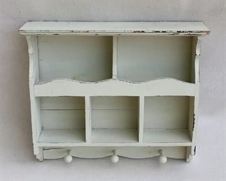 """$30 Distressed hanging shelf.  Wood painted a pale sea foam green, 5 compartments, 3 pegs below, 2 hangers on back.  W: 18.5""""   H: 16""""   D: 4.5"""""""