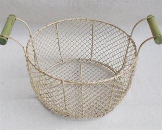 "$30 Wire basket painted cream, 2 green wooden handles.  W: 15""   H: 8.5""   diameter: 11"" [Bin 29]"
