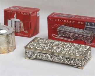 """$40 LOT Left: Silver plate """"Paul Revere"""" jewelry box, incised design, separate lid w/ finial, red velvet-lined,  Victorian Bouquets by Godinger Silver, in box, made in China.  L: 4.5""""   W: 4""""   H: 3""""   height w/ lid: 5.5"""".  Right: Silver plate oblong jewelry box, ornate repoussé, hinged lid w/ mirror, gray velvet-lined compartments, Victorian Bouquets by Godinger Silver, in box, made in China.  L: 9""""   W: 4""""   H: 2""""  [Bin 26]"""