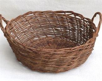 """$20 Basket handwoven of vines, 2 handles of twisted vines.  W: 21""""   H: 9.5""""   diameter: 18.5"""" [Bin 26]"""