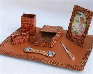 "$75 - Desk set: faux alligator leather, 7 pieces (blotter, pencil holder, letter holder, horizontal paper holder, letter opener, picture frame, paper weight). Brand new, in box.   Blotter dimensions:  19x13"". [Box27]"
