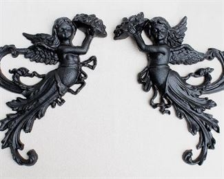 """$60 for set of 2 black cast metal wall plaques, winged cherubs emerging from foliage, holding heaped platters, hanger on backs.  W: 11""""   H: 13""""   D: 1.5"""" [Bin 24]"""