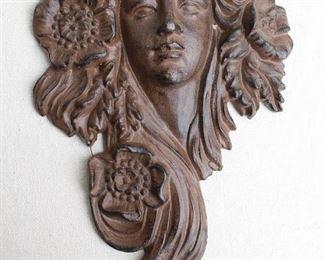 "$60 - Cast metal female head, Art Nouveau style, hanger on back, finish like cast iron that needs blacking.  W: 8""   H: 12.5""   D: 2.5"" [Bin 24]"
