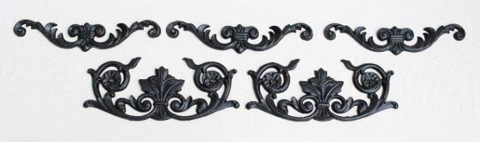"$45 - LOT Upper: Set of 3 black cast metal wall plaques, floral design, 2 holes for hanging.  W: 12""   H: 2.5""   D: 0.5""  Lower: Set of 2 black cast metal wall plaques, floral design, 2 holes for hanging.  W: 12""   H: 5""   D: 0.5"" [Bin 24]"