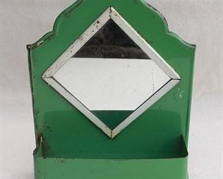 "$20 - Vintage wall mirror w/ galleried shelf, green enameled metal, hole for hanging.  W: 8.5""   H: 11.5""   D: 3""   diamond-shaped mirror dimensions:  4.5x4.5"" [Bin 22]"