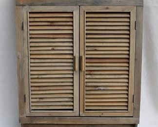 """$120 - Wall cabinet, natural wood, 3 shelves, louvred doors w/ magnetic closures, 4 pegs below for hanging items.  W: 25""""   H: 32""""   D: 5"""""""