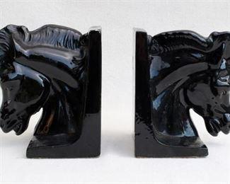 "$30 - Pair of black-glazed ceramic horsehead bookends.  W: 6""   H: 76.5"" [Bin 19]"