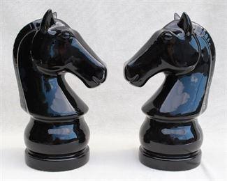 "$20 - Pair black ceramic horseheads (like knights on a chessboard).  Each L: 8""   W: 6""   H: 13"" [Bin 19]"