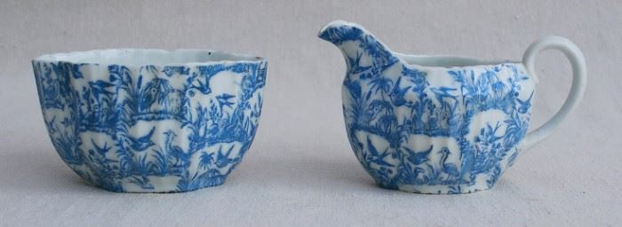 """$30 - Porcelain creamer and sugar bowl, white w/ blue swallow design inspired by willow ware.  W: 4""""   H: 2.5""""   D: 3"""" [Bin 17]"""