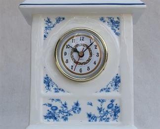 "$40 - Ceramic carriage clock, white w/ ""blue toile"" design, Our America , new in box.  W: 6""   H: 8.5""   D: 3.5"" [Bin 17]"