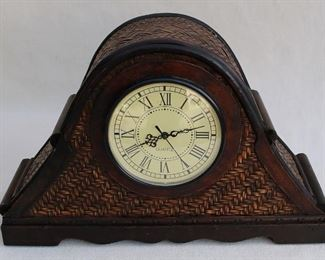 """$20 - Mantel clock, dark wood and dark-stained woven cane, dial has Roman numerals & ornate hands, Three Hands Corp., takes 1 AAA battery.  W: 19""""   H: 12.5""""   D: 6"""""""
