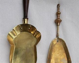 "$40 - LOT Left: Brass fireplace shovel, short wooden handle.  L: 14""   W: 6.5""  Right: Brass fireplace shovel, ring for hanging.  L: 12""   W: 4.5"" [Bin 15]"
